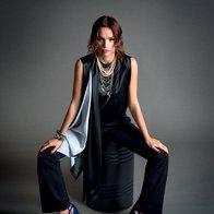 Kombinezon Givenchy; ogrlica Tom Binns;  sandale Valentino;  zapestnica iz vrvi in kristalov Shourouk; zapestnica  Li Da Jewelry. (foto: Decker + Kutić)