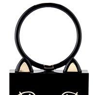 Muckasta torbica Charlotte Olympia.  Za 795 evrov  (foto: promocijsko, profimedia, imaxtree)