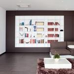 Precej pohištva je izdelanega po meri, med drugim tudi velika knjižna omara, ki predstavlja osrednji element v odprtem dnevnem prostoru. (foto: Fulvio Grissoni)