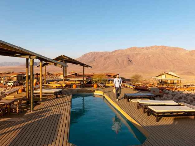 Simpatična lesena domovanja vključujejo tudi zasebne bazene.  - Foto: Profimedia